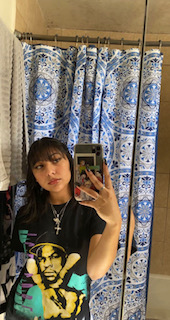 Bathroom selfie with fringe and a graphic t-shirt